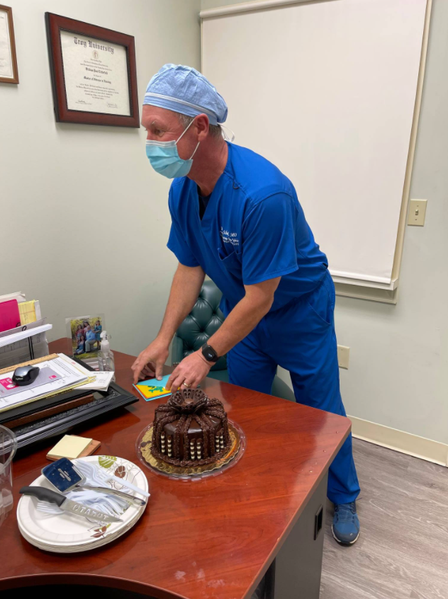 Dothan Dr Schul with cake
