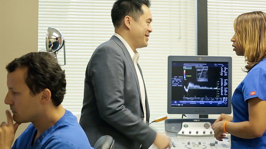 Dr Nguyen as he reviews a one month post procedure follow up scan