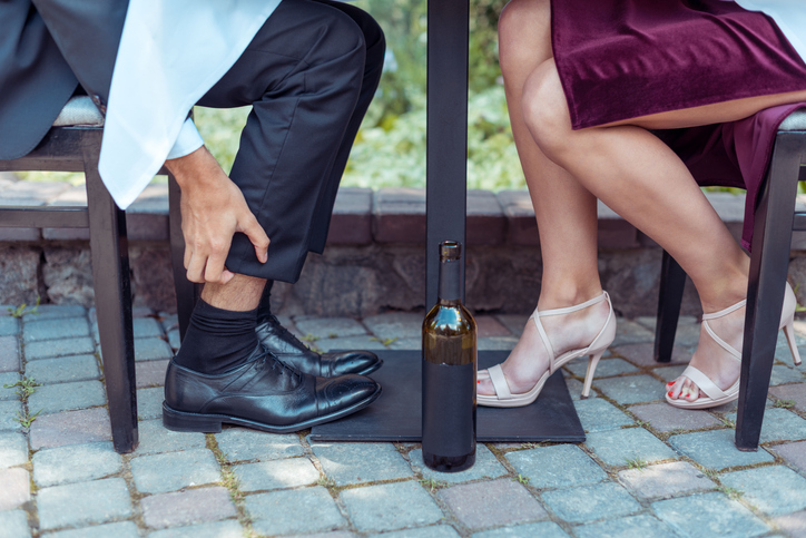 Man and woman ankles under table