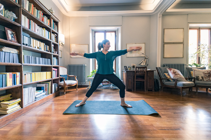 Woman in living room yoga