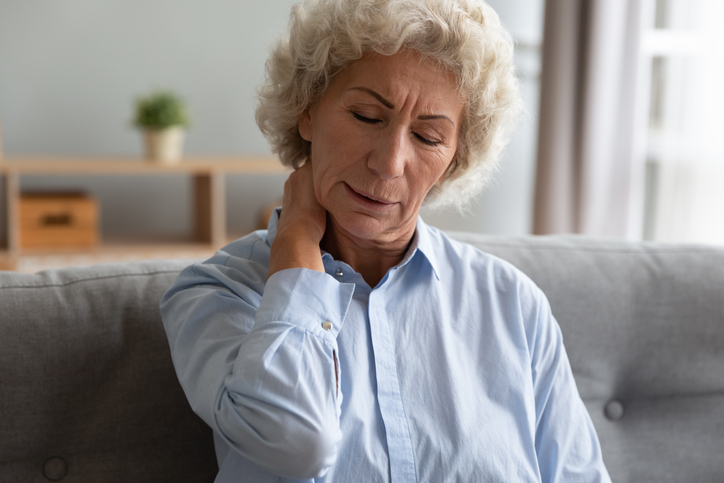 Woman on couch with neck pain