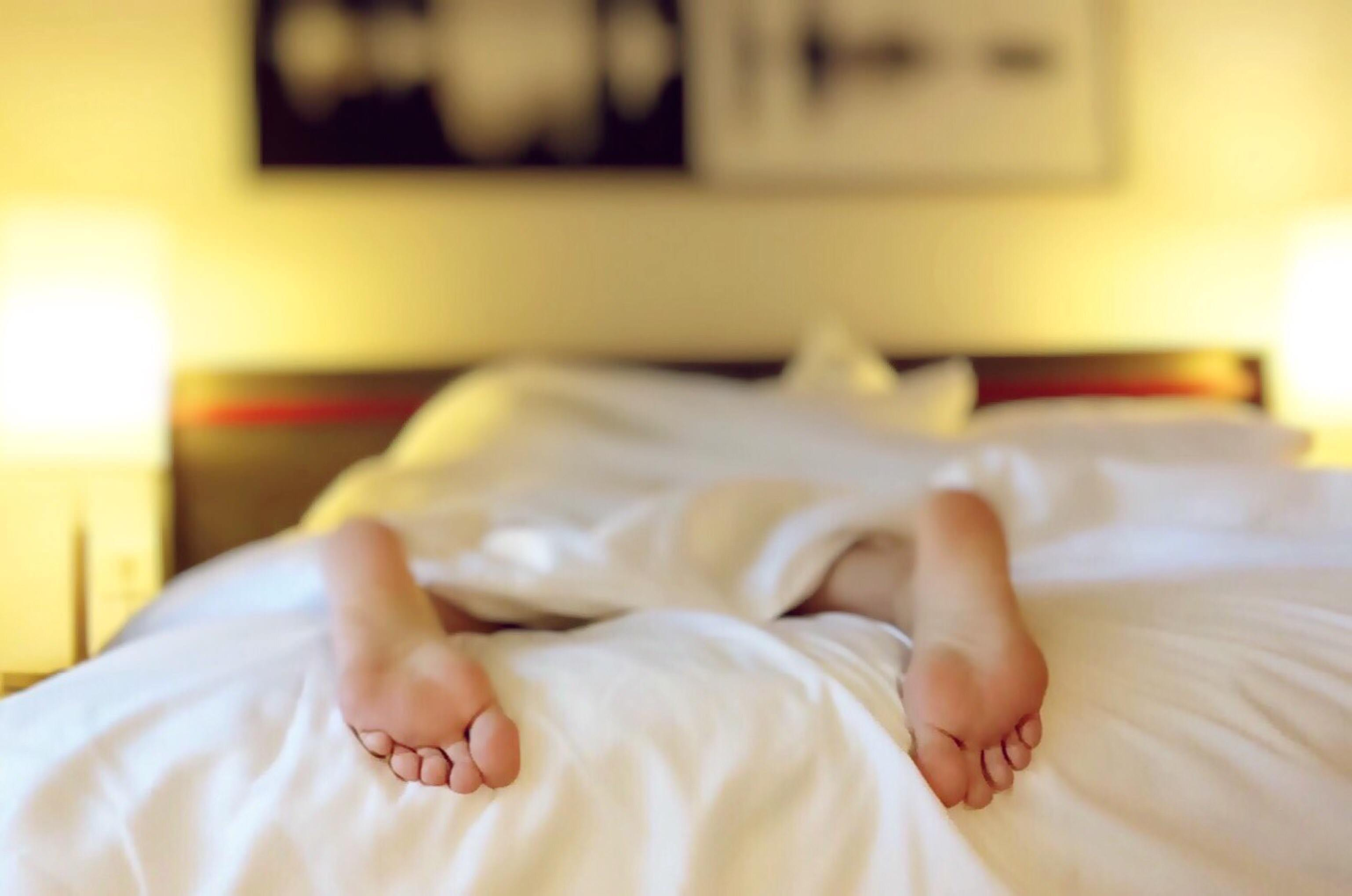 healthy feet at hotel bed sleeping